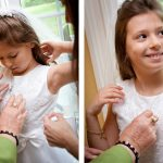 grandma puts on a cross necklace before a young girl makes her communion New jersey communion photographer