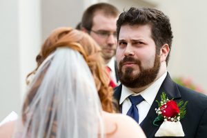 groom makes funny face during ceremony